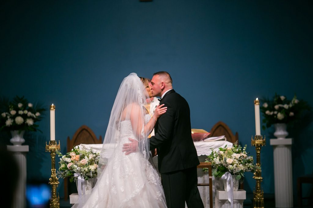 A couple kissed during their wedding ceremony