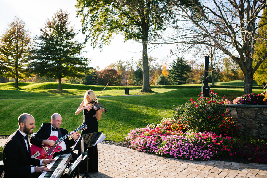 A live wedding band plays outside at West Hills Country Club
