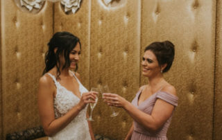 Bride and Maid of honor toasting in The Grandview's Wedding Suite